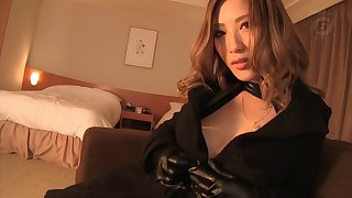 Stunning Asian cowgirl in leather giving a steamy blowjob